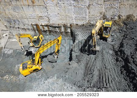 Excavators Baggers Digging At A Construction Site