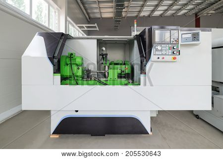 CNC grinding machine. Grinding of cylindrical parts.