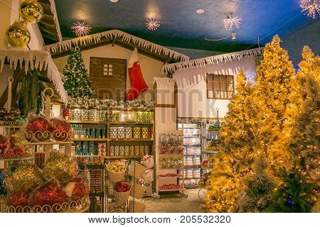 VETRALLA, ITALY - SEPTEMBER 23, 2017: The reign of Santa Claus: beautiful christmas shop with balls, tree and decorations