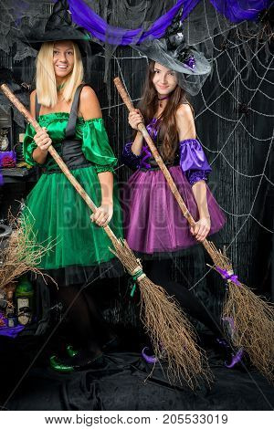 Two Adorable Sorceresses With Brooms To Halloween