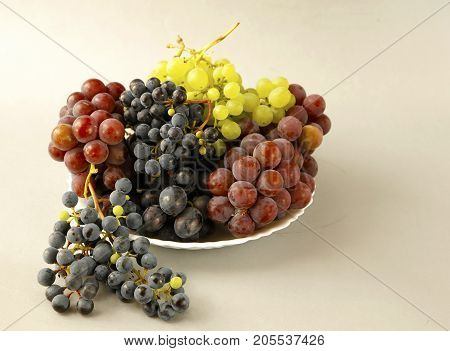 Juicy Grapes Or A Frame With Grape On The White
