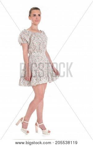 Young beautiful happy blonde woman in summer blue dress isolated on white background