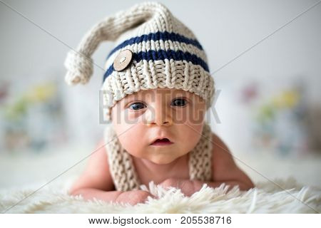 Little Newborn Baby Boy, Looking Curiously At Camera