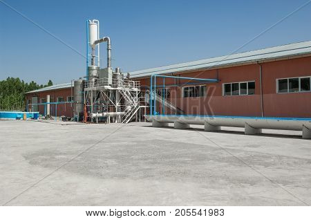 Storage Tank And Building