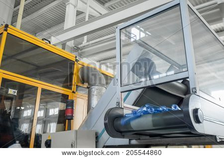 equipment for the manufacture of preforms for plastic bottles. PET production. on the conveyor the flask preform for plastic bottles poster