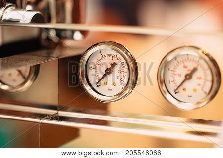 close up pressure gauge pound per square inch (psi) at coffee espresso machine