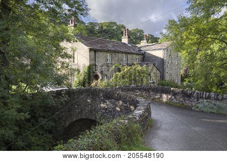 Stone cottage and bridge Kettlewell Yorkshire Dales National Park England.