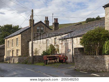 Old farm buildings Kettlewell village Yorkshire Dales National Park England.