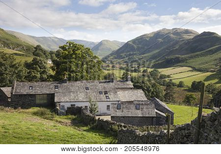 Old farm from Hallin Fell with Howe Grain in background the Lake District Cumbria England.