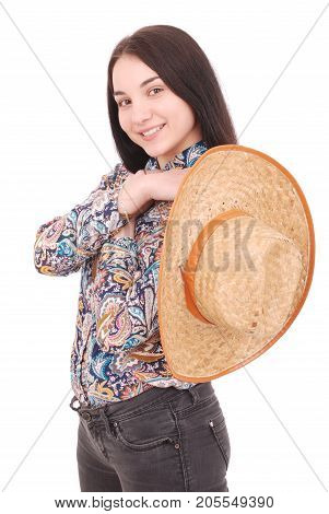 Pretty young woman wearing a big floppy straw sun hat isolated on white