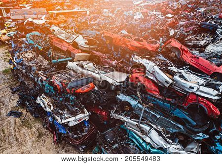 Destroyed Scrapped Cars Stacked On A Scrap Yard.