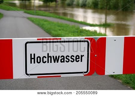 Hochwasser - German for high water - flood barrier sign due to flooding in Germany