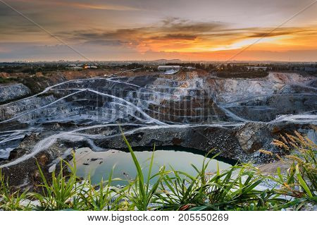 opencast mining quarry with beautiful sunlight and cloudy sky Aerial view industrial