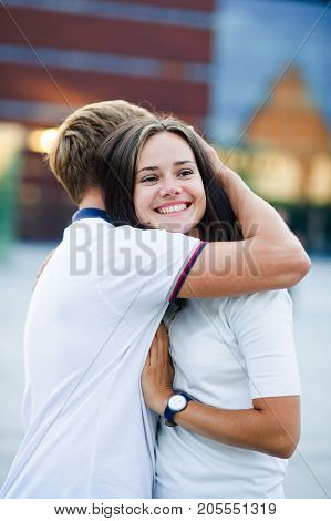 The guy and the girl stand having embraced. Love tenderness.