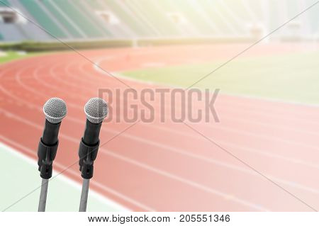 sports commentator with running field stadium background with space for text