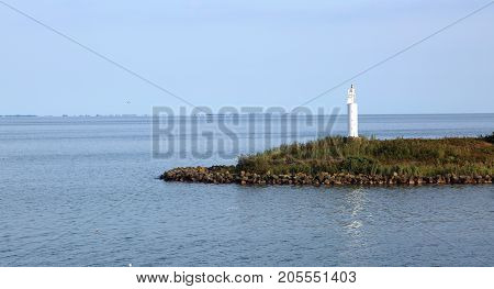 Great Lighthouse Amidst The Dutch Artificial Lake Called Ijsselm