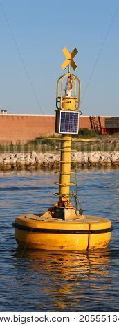 Industrial Yellow Buoy For Signaling To Ships With A Small Photo