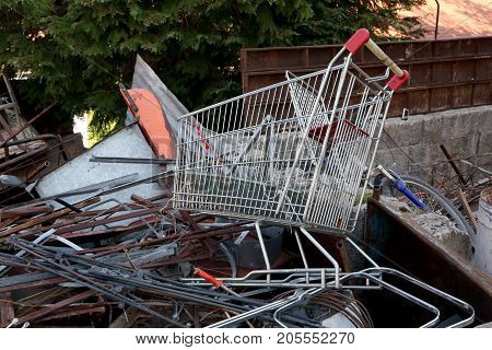 rusty shopping trolley in the recycle bin of the ferrous material to be recycled