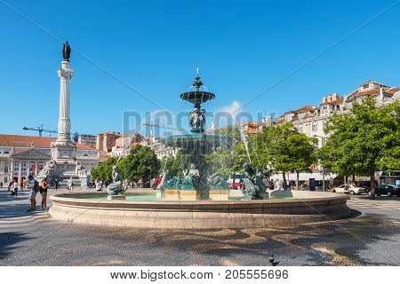 LISBON PORTUGAL - AUGUST 31 2017: The Dom Pedro IV Monument and fountain at Rossio Square in the central Baixa district