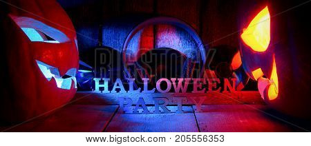 The Concept Of Halloween. Two Glowing Oranjous And Blue Light Angry Scary Pumpkin With Headphones An