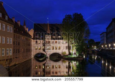 Hospital of the Holy Spirit on Pegnitz river Nuremberg Germany. Evening