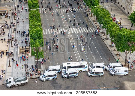 PARIS, FRANCE - JULY 2, 2017: checkpoint at entrance of Champs Elysees of French police gendarmerie, keeping security after recent terrorist attacks in Paris. View from Arc de Triomphe.