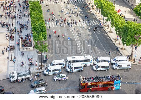 PARIS, FRANCE - JULY 2, 2017: French police gendarmerie, keeping security with checkpoints at Place Charles de Gaulle in Paris, for tourists at Arc de Triomphe with touristic bus.