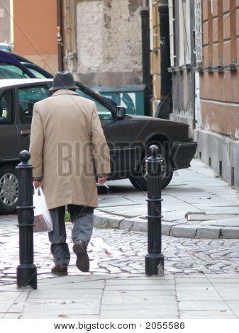 Elderly Man Crossing A Street