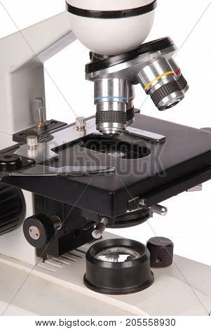 Monocular laboratory microscope isolated on white background with soft shadow. Close-up