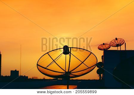 Satellite Dish On Top Of Building With Sky Sunset Digital Television And Home Networking Communicati