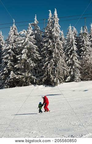 Little Boy And Ski Trainer On Mountain, Color Image, Two People