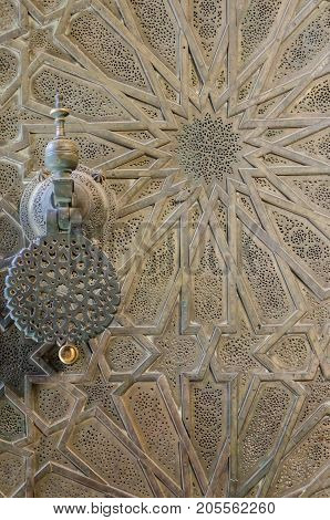 Elaborate metal door of Bou Inania Madrasa with star pattern and beautiful door handle, Fes, Morocco, North Africa.