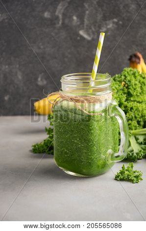 Fresh green smoothie with kale and banana, selective focus.