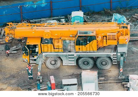 Many Truck And Crane In Yard Site Consist Of Lifting, Pulley, Sling, Derrick Are Ready For Construct