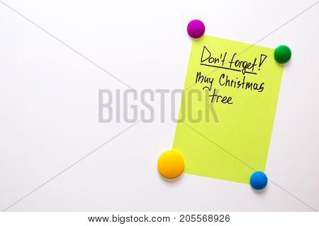 Fridge note with the text: Don't forget! Buy christmas tree