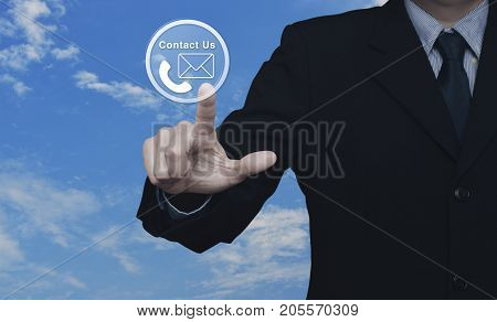 Businessman pressing telephone and mail icon button over blue sky with white clouds Contact us concept