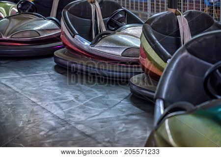 Close up several electric bumper cars in amusement park circuit autodrome