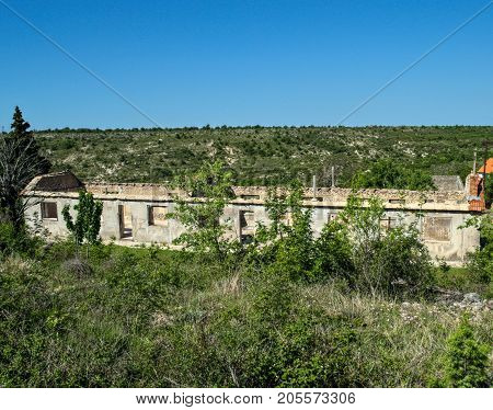 Old ruined abandoned house with only walls remained