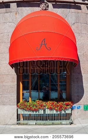 SAINT PETERSBURG RUSSIA - AUGUST 15 2017. Red awning of famous Astoria hotel in Saint Petersburg Russia in sunny day