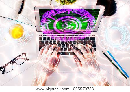 Top view of abstract cyborg circuit hands using laptop with digital button placed on white office desktop with supplies and other items. Futuristic concept