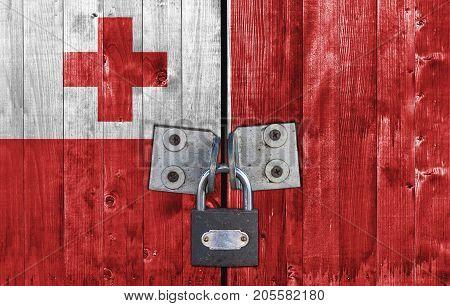 Tonga flag on door with padlock close