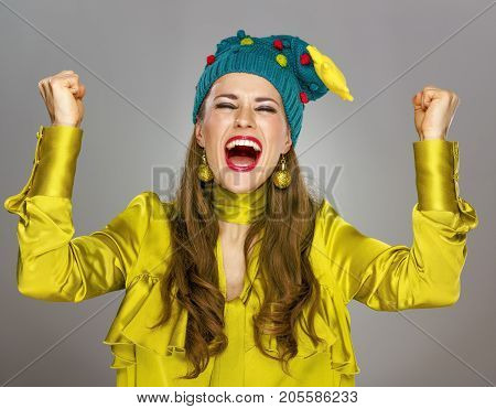 Woman In Christmas Hat Isolated On Grey Background Rejoicing