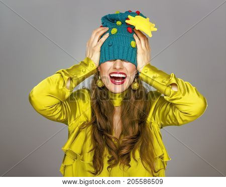 Smiling Woman Isolated On Grey Christmas Hat Stretched Over Eyes