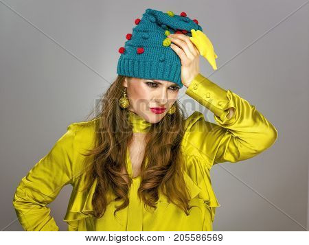 Stressed Stylish Woman In Funny Christmas Hat Isolated On Grey