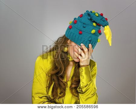 Stressed Woman In Christmas Hat Isolated On Grey Background