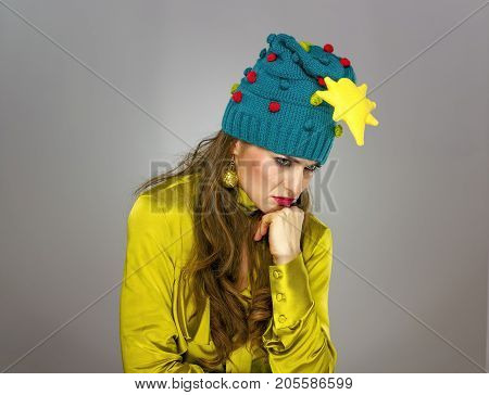 Stressed Woman In Christmas Hat Isolated On Grey Thinking