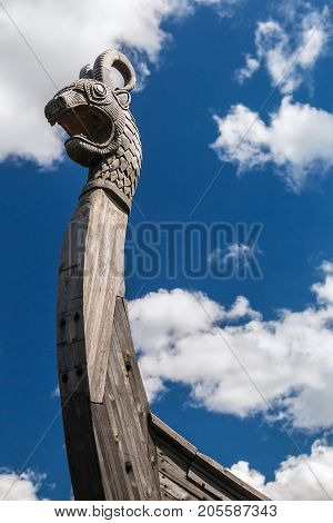 head of a dragon on the front of the Viking ship Drakkar. focus on the head