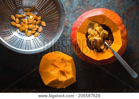 Seeds in a colander, pumpkin for making pumpkin soup horizontal