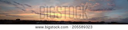 Multicolored clouds above the city / Beauty of nature / Sunrise over the city / Sunset over the city / City and sky panorama