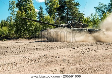 Main battle tank are going to dust on a forest road in military exercises